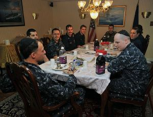 "A photo of the ""Pre-Pesach Seder"" conducted the night before Sampson arrived aboard the USS Enterprise. (U.S. Navy photo by Mass Communication Specialist 3rd Class Nick C. Scott/Released)"